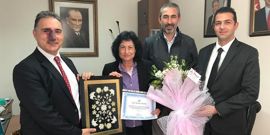 Koopbank'ın en eski kadın çalışanı onurlandırıldı