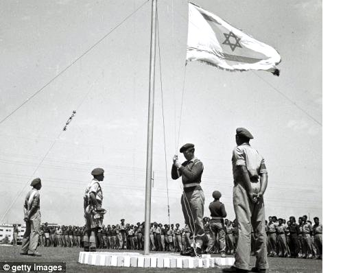 25-08-2019--left,-less-than-three----weeks-before-israels-independence,-the-flag-of-the-future-jewish-state--is---raised-at-morning-parade-at-a-training-base-on-april-27.jpg